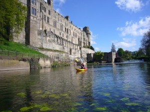 Sophie kayaks past Warwick Castle